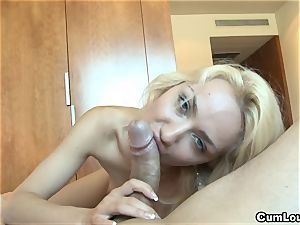 kinky blondie pleasuring a large man meat with her forearms