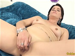 old cougar pleases Herself with playthings